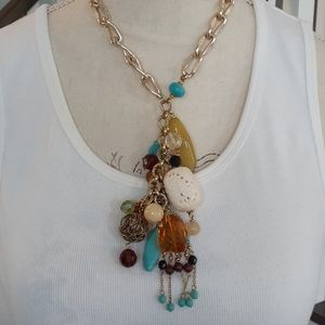 Cascading charms statement necklace